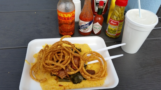 BBQ pork, turnip greens and onion rings on cheesy grits.